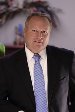 ESI Equity team member Craig D. Olinger.